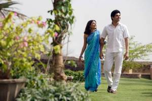 69306261-young-couple-strolling-in-garden